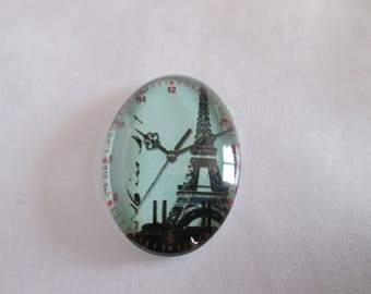 a cabochon glass 25 x 18 mm Eiffel Tower Clock