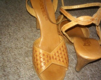 Buskens sling back ankle strap peep toe,made in brazil, carved wooden sole with nearly no use on the rubber sole