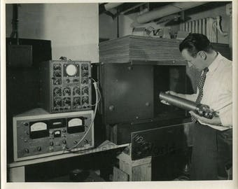 Scientist analyzing ground antique science photo
