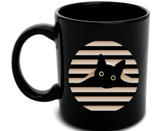 Black cat in window black mug