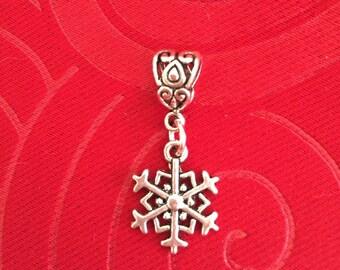 Silver snowflake charm