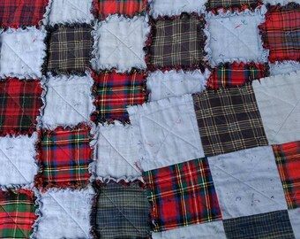 Ragtime quilt of cotton and flannel. Backing is of the same material with quilt batting in the center. QT13