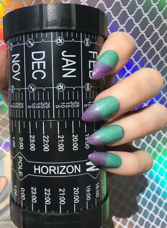 Northern Lights color changing nail polish purple to teal thermal vegan holographic