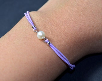 Bracelet freshwater pearl light purple cord