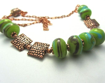 Lime green lamp work beaded NECKLACE with square copper snakeskin pattern beads with magnetic clasp. Whole  OOAK set is available