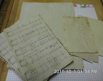 tea or coffee dyed paper,music sheets, index cards
