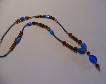 Long necklace, long blue and amber, glass beads.