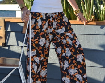 Navy blue elasticated waist, wide legged pants with white and orange floral pattern - Florence