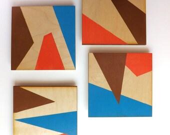 4 wood panel geometric paintings