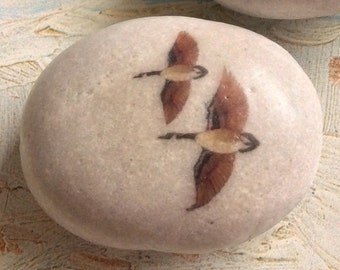 Canada Geese #2 on a natural, polished river stone.