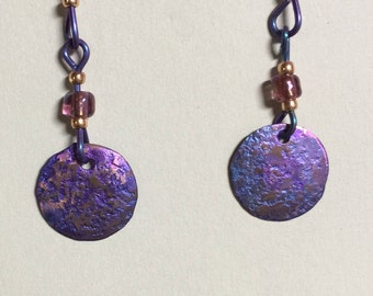 Anodized Titanium dangle disc earrings in blue/purplely/pink.  On hypoallergenic Niobium earwires.