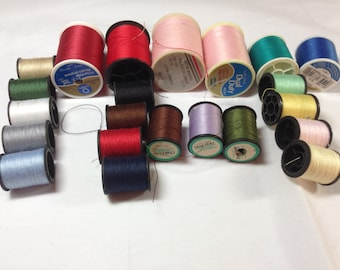 Twenty One Spools of Thread Includes Four Large Spools, Two Medium Size Spools, and 16 Small Spools of Thread Previously 12 Dollars ON SALE