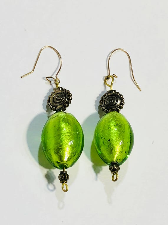 SJC10023 - Green oval glass bead earrings with gold plated ear wires and brass spiral beads