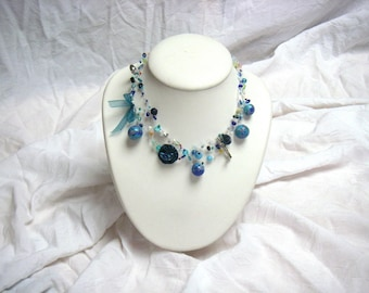 Blue and turquoise, fimo beads, seed beads, fabric yoyo, key necklace...