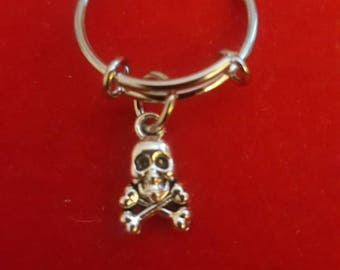 Silver Skull and Crossbone Adjustable Charm Ring.