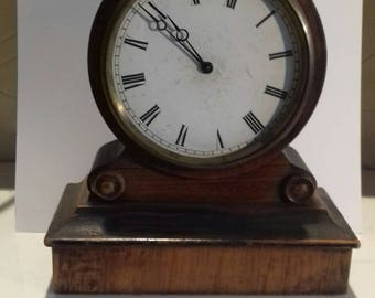 A small 19th century  French simulated rosewood mantel time piece