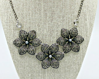 Statement trio Oxidized Medallion metal flower and on 18 inch chain