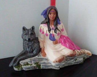 Indian maiden sitting with wolf