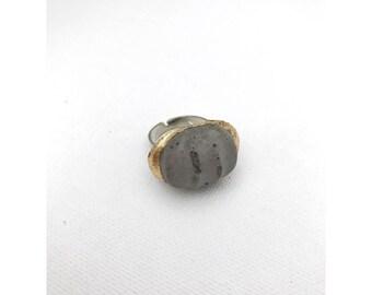 Gold foiled concrete grooved adjustable ring