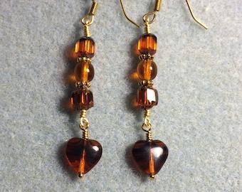 Orange brown striped Czech glass heart bead dangle earrings adorned with orange brown Czech glass beads.
