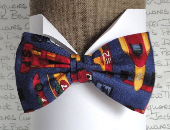 """Bow tie, pre tied or self tie, racing cars on blue background, will fit neck size up to 20"""" (50cms)"""