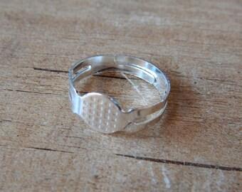 10pcs. Shiny silver tone adjustable ring blanks