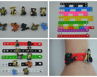 How To Train Your Dragon Silicone Charms and Bracelets. Great for birthday party favors, cupcake cake toppers, giveaways and game prizes.