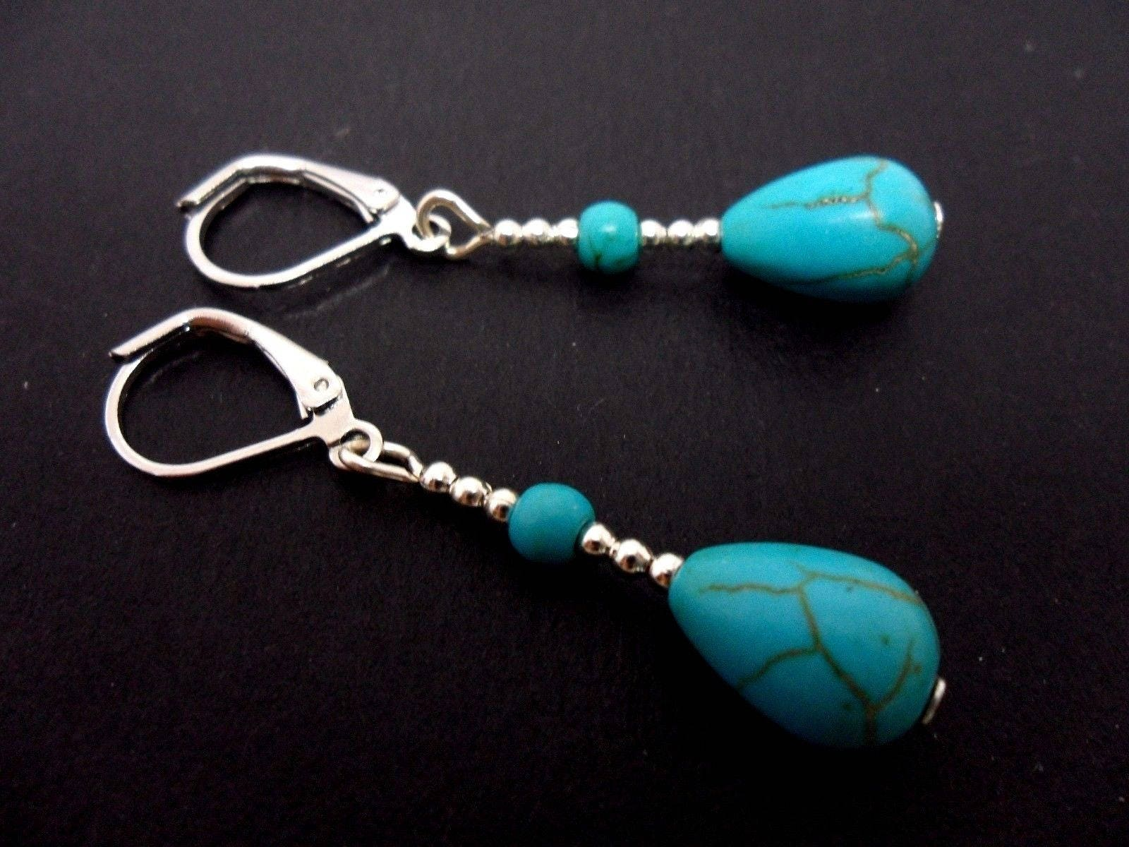 A pair of pretty hand made tibetan silver turquoise teardrop bead dangly leverback hook earrings. new.