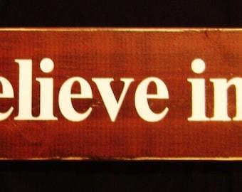We Believe in Santa rustic sign