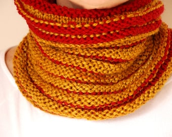 knitted wool cowl in burnt yellow and fucsia.