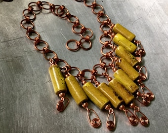 copper link necklace with chartreuse brown ceramic bead fringe and spirals.