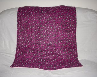 Pet Blanket - pretty dark raspberry colored cheetah print with solid candy cane pink fleece on the reverse side.