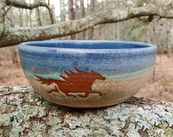 The wild horses of Corolla gallop around the outside of this sweet cereal bowl
