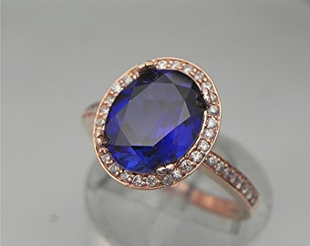 AAA Manmade Blue Sapphire   10x8mm  2.99 Carats   in a 14k ROSE gold ring with diamonds (.32ct) Ring 1131 MMMM