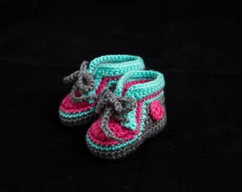 Handmade Crocheted baby shoes for a girl.