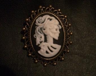 Skeleton cameo brooch