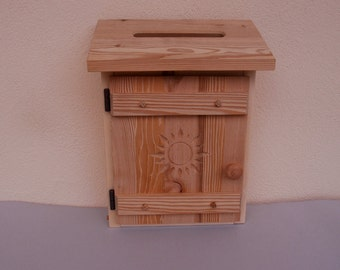 Mail box from wooden rustic with a Sun motif without window