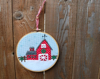Embroidered red barn in the snow wall hanging