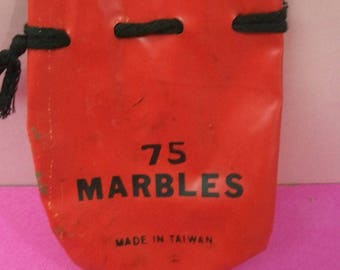 Red Marble Bag 75 Marbles On Front Made In Taiwan Vinyl Marble Bag With Black Drawstring Lots of Scuffing And Wear No Marbles