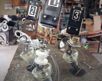 Custom Junk Metal Trophies Recycled Glass, Ceramic, & Industrial Parts
