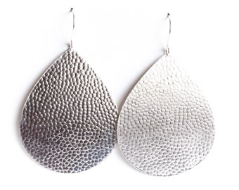 "Eye-catching dangle sterling silver earrings with a hammered bubble texture on a sleek teardrop shape - ""Large Juno Earrings - Silver"""