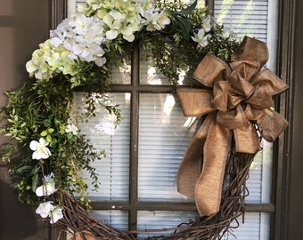 Natural grapevine wreath with greenery and hydrangeas