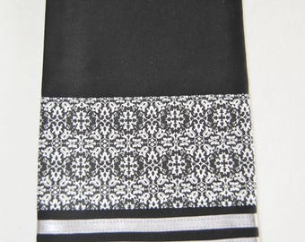 Tea towel with black and white patterned border