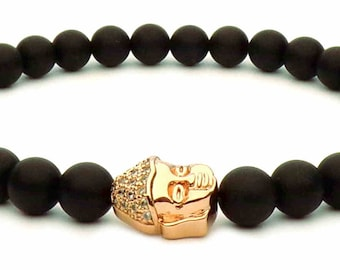 The bracelet rose gold Buddha