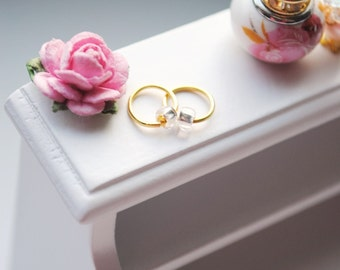 Jewellery  for miniature dollhouse lady's room decor. Tiny golden jewelry for miniature lady's beauty room.