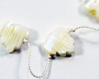 Onyx Hearts Knotted on White Silk Cord Necklace