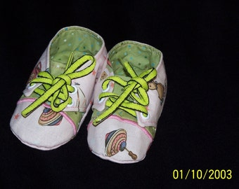 Sneaker Style Baby Girls Booties, Pink with Toy Print Fabric.