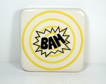 tile in yellow pinstripe bullseye with a BAM print. ready to ship
