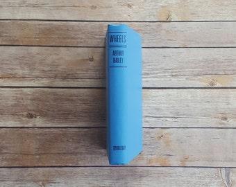 Automobile Fiction Story Wheels Arthur Hailey 1970s Men's Novel Ford Motor Fictionalized Car Book 70s Powder Blue Hardcover Fiction Novel