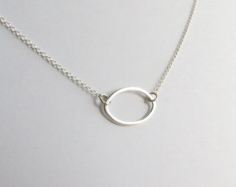 Minimalist Sterling Silver Petal Silhouette Layering Necklace. Delicate silver petal necklace. Dainty layering necklace.